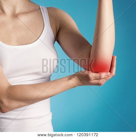 Rheumatism. Elbow injury and pain indicated with red on female arm.