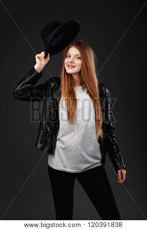 Portrait Of Beautiful Young Girl Wearing Black Felt Hat And Leather Jacket