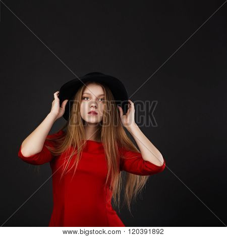Full-length Portrait Of Beautiful Young Girl In Red Dress And Black Felt Hat.
