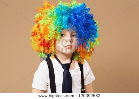 Sad Clown Boy With Large Colorful Wig.