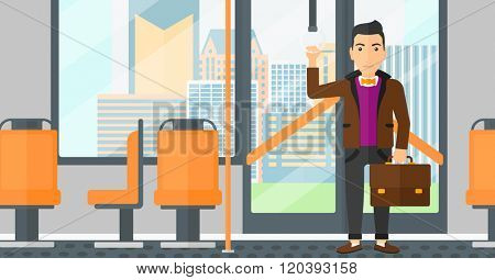 Man standing inside public transport.