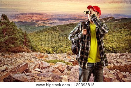 Man finder with binocular standing on stones