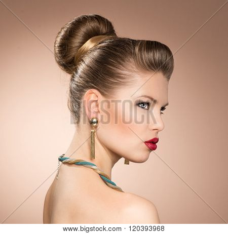Portrait of retro red lips stylish woman with golden jewelery