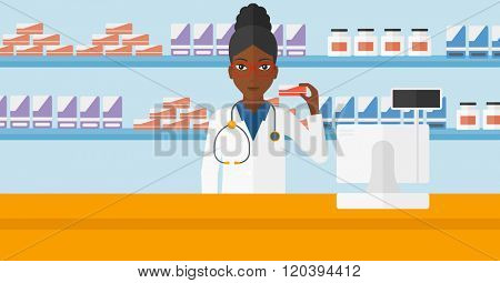 Pharmacist showing some medicine.