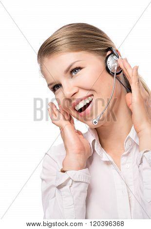 Joyful female support operator with headset, isolated on white
