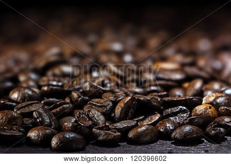 Coffee Background, Closeup Of Dark Brown Roasted Coffee Beans, Copy Space