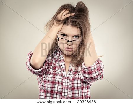Confused woman in tension thinking about problem solution