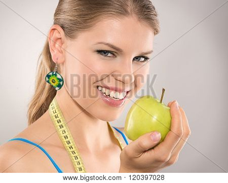 Happy diet woman loosing weight by eating healthy food