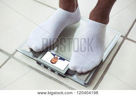 Man's feet on bathroom scale. Diet concept