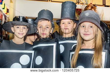 Children wearing Domino costumes