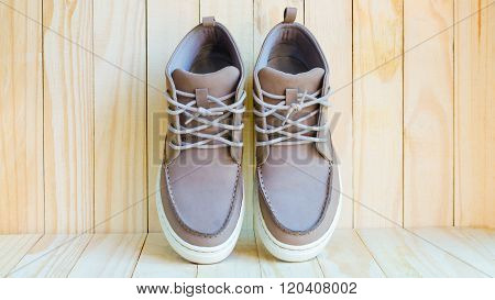 gray suede shoes fasion on wooden background