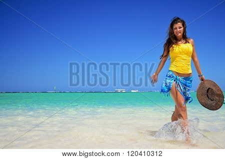 Young woman relaxing on tropical carribean beach