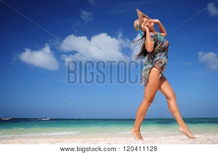 Young woman dancing on exotic carribean beach