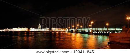 Night panorama of Saint Petersburg with colourful illumination reflecting in Neva river