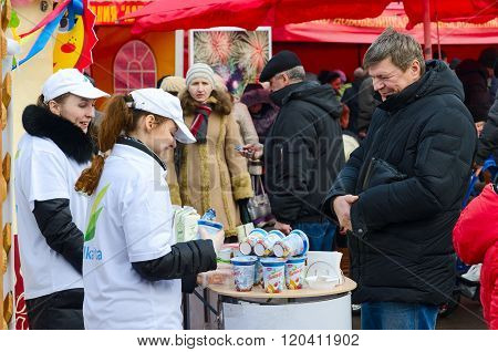 Tasting Of Dairy Products At Fair During Shrovetide Festivities