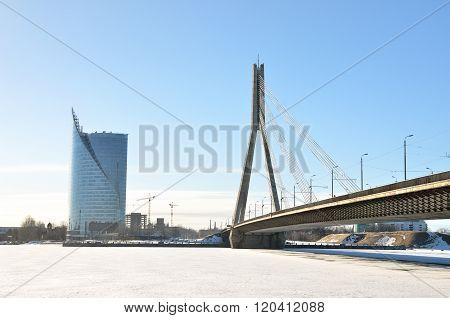 Panorama of Riga. Cable Bridge and Saules Akmens skyscraper. Frozen Daugava winter view.