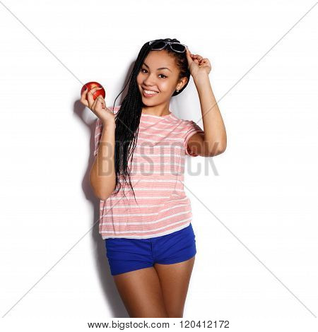 Attractive young mulatto girl posing in the studio on a white background