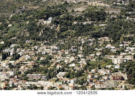 Densely Populated City On Mountain