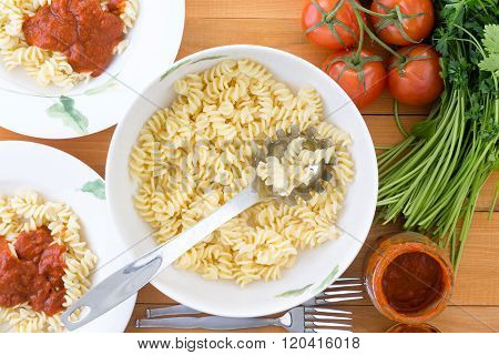 Top Down View Of Pasta And Spoon In Bowl