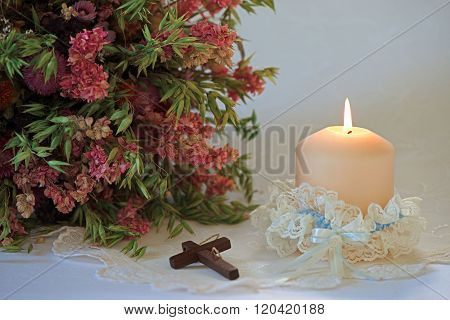 Wedding set up with candle and cross