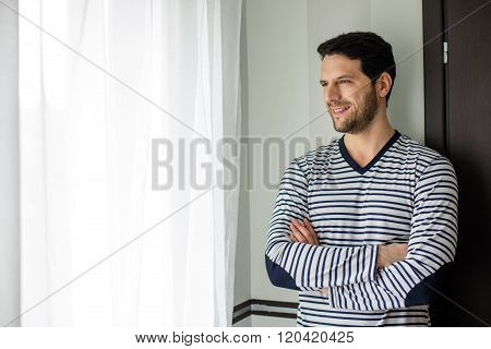 Handsome Man In Pajams Next To Window