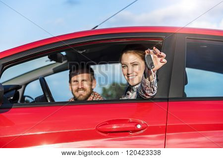 Couple in the red car.
