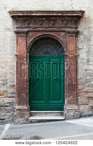Green Wooden Door With Arch And Decoration