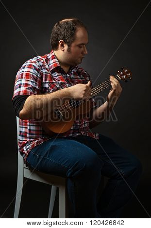 Portrait Of Musician With Ukulele