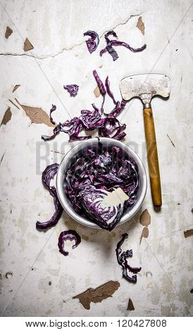 Fresh Cabbage With A Hatchet.