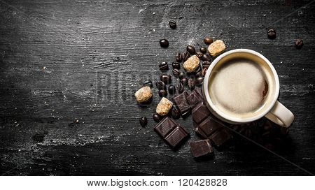 Cup Of Coffee With Bitter Chocolate And Dark Brown Sugar.