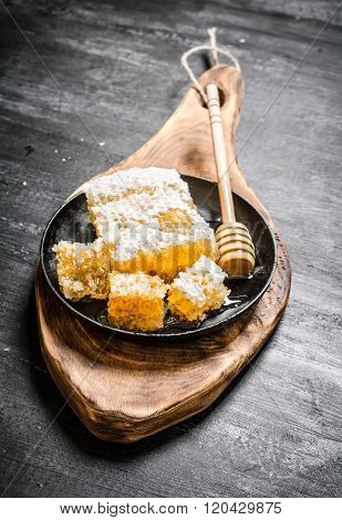 Honey In The Comb With Spoon