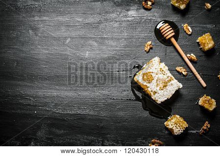 Honey Background. Natural Honey Comb And A Wooden Spoon .