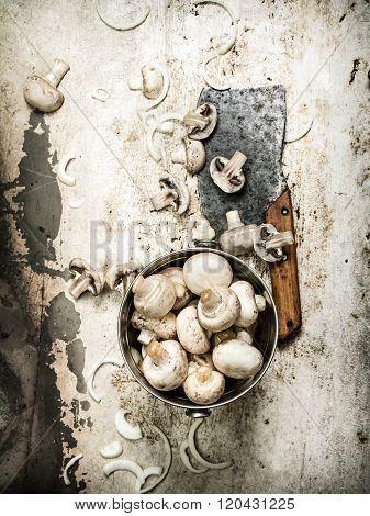 The Mushrooms In The Pot And An Old Hatchet.