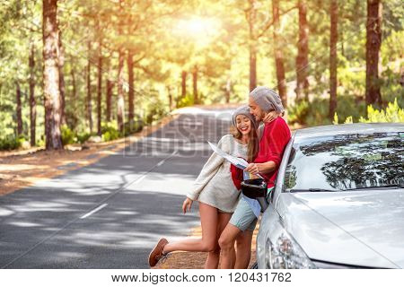 Couple traveling by car in the forest