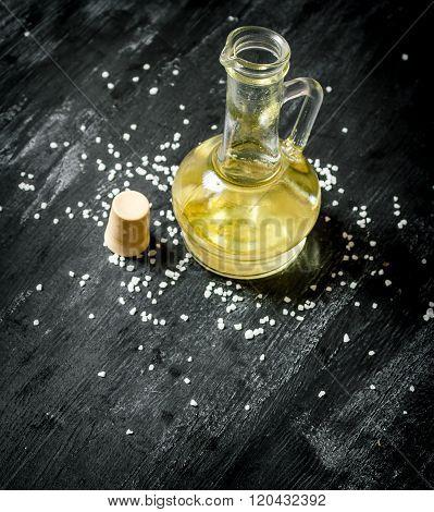 Fresh Olive Oil In Glass Jar. On Black Rustic Background.