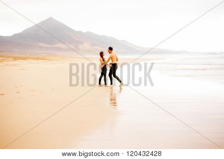Couple with naked torso on the beach