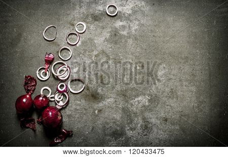 Red Onion Cut Into Rings. On Stone Background.