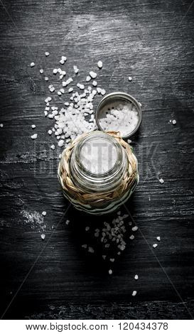 Coarse Salt In Saltcellar. On Black Rustic Background.