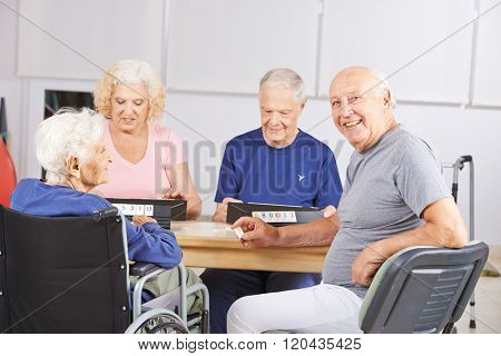 Group of senior people playing game in a nursing home