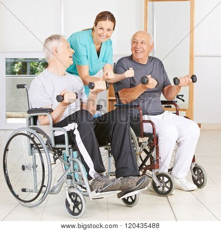 Physiotherapist with two senior men in wheelchairs lifting dumbbells