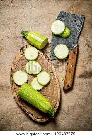 Sliced Zucchini And An Old Hatchet .