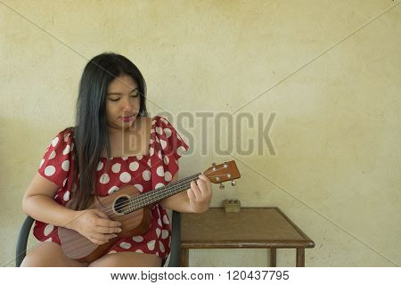 Woman Play Ukulele