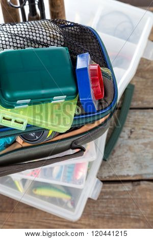 Fishing Tackles And Baits In Box And Bag