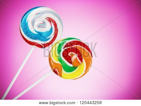 Colorful lollipop on a purple background lolly
