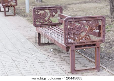 Bench in the park with vintage armrest