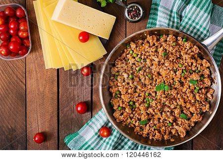 Minced Meat In A Frying Pan For Stuffing Lasagna. Top View