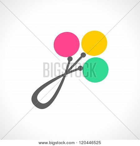 Colorful baby rattles in pink green and yellow isolated on white background