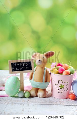 Easter Card With Clay Rabbit  And Decorations On Spring Background