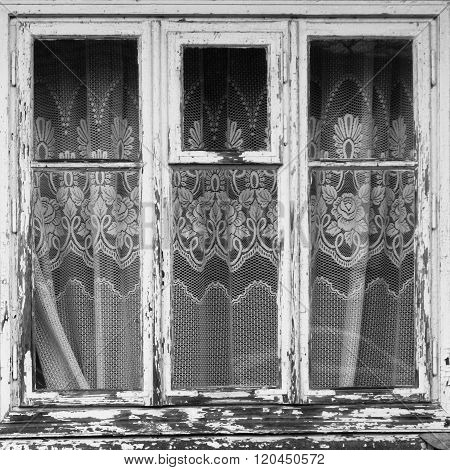 Closed old window with curtain