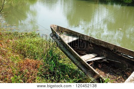 Empty weathered wooden boat